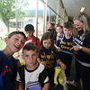 Last day of school at Vining Elementary School before it closes. Front, from left, Justin Pappalardo, 10, and his brother Michael, 8, Isabella Allaby, and Jaden Hubis with staff member Emily Ward, as walkers wait to be called to meet their parents. (SUN/Julia Malakie)