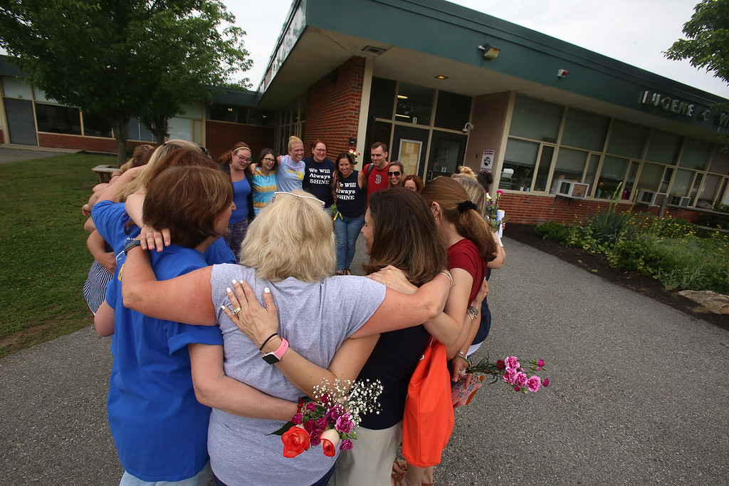 . Last day of school at Vining Elementary School before it closes. Teachers and staff members have a group hug after seeing off the kids. (SUN/Julia Malakie)