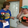 Last day of school at Vining Elementary School before it closes. Retiring teacher Ilona Sewell of Billerica, left, talks with Beth Broughton of Billerica, whose four kids, Shelby, Sarah, Skylar and Tucker, all had Sewell as a teacher. Broughton was wiping away tears after giving Sewell flowers. (SUN/Julia Malakie)