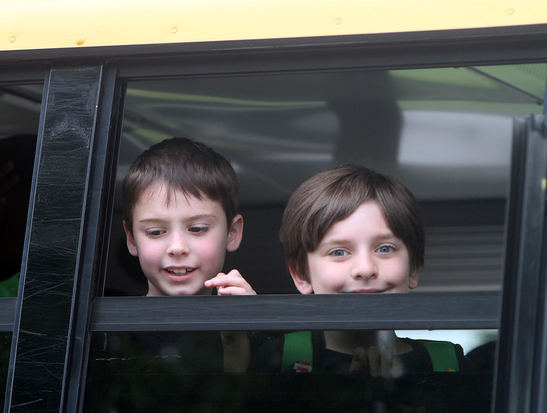 Last day of school at Vining Elementary School before it closes. Liam Cullen, who just finished second grade, and CJ Mailloux, first grade, look back at teachers as the bus leaves. (SUN/Julia Malakie)
