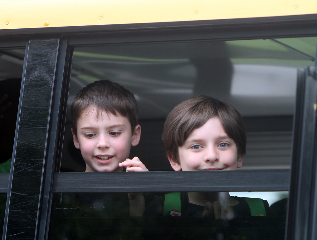 . Last day of school at Vining Elementary School before it closes. Liam Cullen, who just finished second grade, and CJ Mailloux, first grade, look back at teachers as the bus leaves. (SUN/Julia Malakie)