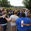 Last day of school at Vining Elementary School before it closes. Teachers and staff members have a group hug after seeing off the kids. (SUN/Julia Malakie)