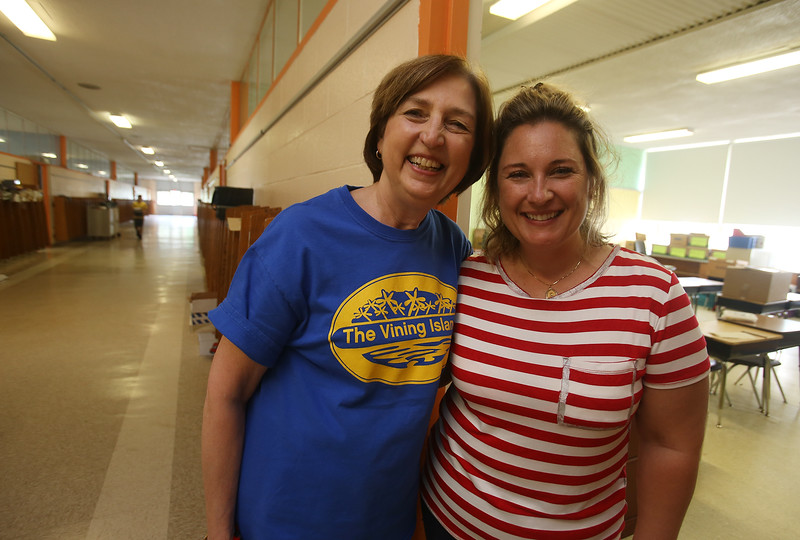Last day of school at Vining Elementary School before it closes. Retiring teacher Ilona Sewell of Billerica, left, and paraprofessional in her classroom, Ann Laquidara of Billerica. (SUN/Julia Malakie)