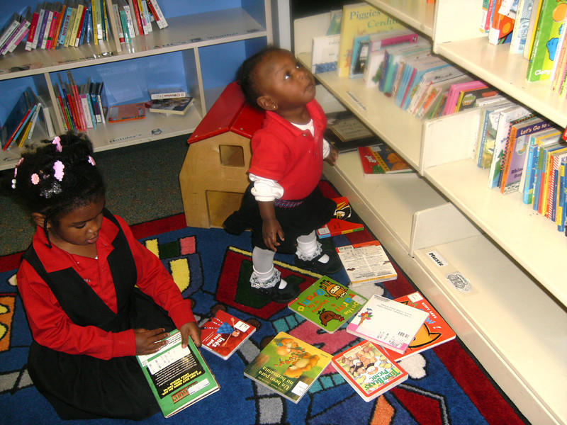 Tenia & Lauryn enjoying the library.