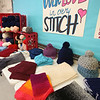 Sixth graders at Dr. An Wang Middle School knit and crochet during advisory period, making scarves and other items to donate to the Lowell Transitional Living Center. These are some of their finished items. (SUN/Julia Malakie)