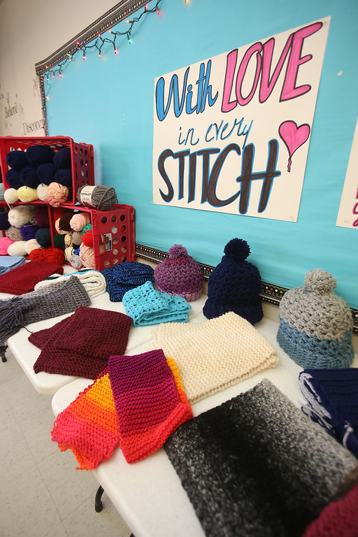 . Sixth graders at Dr. An Wang Middle School knit and crochet during advisory period, making scarves and other items to donate to the Lowell Transitional Living Center. These are some of their finished items. (SUN/Julia Malakie)