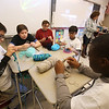 Sixth graders at Dr. An Wang Middle School knit and crochet during advisory period, making scarves and other items to donate to the Lowell Transitional Living Center. From left, Brandon Rivas, 11, Chase Ziemba, 12, Luis Bodon, 11, Dhruv Patel, 11, and Ronald Dossa, 11. (SUN/Julia Malakie)