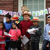 Washington Elementary School in Lowell holds a celebration for their new Peace Garden. From left, 3rd graders Saphira Sao, Hana King, Oziel Gomez, Hillary Tap, Chancen Croxford, Reton Chim, Anthony Nheb and Michael Cafna, with principal Cheryl Cunningham, reading statements about peace. (SUN/Julia Malakie)