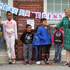 Washington Elementary School in Lowell holds a celebration for their new Peace Garden. From left, 3rd grader Ethan Do, 2nd grader Taylor Deadrick, 1st grader Isiah Powell, 2nd grader Aundre Rivera (speaking) and principal Cheryl Cunningham. (SUN/Julia Malakie)