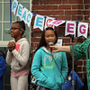 Washington Elementary School in Lowell holds a celebration for their new Peace Garden.  From left, 2nd graders Aundre Rivera and Taylor Deadrick, and 4th grader Megan Xayasane. (SUN/Julia Malakie)
