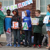 Washington Elementary School in Lowell holds a celebration for their new Peace Garden. From left, principal Cheryl Cunningham, and 4th graders Raymond Edjejovwo, Christian Phauk, Logan Chouinard, Brendan Hackett and Kathleen Fernandes, all 9. (SUN/Julia Malakie)