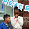 Washington Elementary School in Lowell holds a celebration for their new Peace Garden. 2nd graders Aundre Rivera and Taylor Deadrick.  (SUN/Julia Malakie)