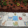 Washington Elementary School in Lowell holds a celebration for their new Peace Garden.  Tiles made by the different classrooms. (SUN/Julia Malakie)