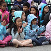 Washington Elementary School in Lowell holds a celebration for their new Peace Garden. Fourth graders, left to right, front row:  Emily Chea, Jailyn Ngen, Narya Yoth and Blake Duby. Second row: Jacqueline Gonzalez, Jezabel Dominguez, Cashone Norinth, Yalexy Sanchez, Darrin Yin, Cayla Mey, Lani Phimmady, Chloe Dodge and Davina Chann.(SUN/Julia Malakie)