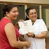 Charlene Lazarus receives a volunteer award at Aboriginal Headstart