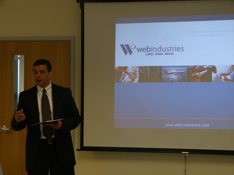 Web Industries General Manager Ron Giard outlines the curriculum being offered to Web Industries employees.