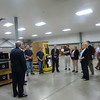 Web Industries General Manager Ron Giard discussing the manufacturing process at the company to MassBay, state, and company officials.
