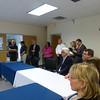 Senator Karen Spilka (D-Ashland), Web Industries employees, MassBay and Massachusetts Department of Higher Edcuation officials listen intently to the presentation from Web Industries executives.