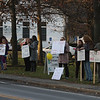 Members of Westford Education Association, the teachers' union, hold signs at Town Common to protest expected school budget cuts. (SUN/Julia Malakie)