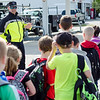 Sgt. Bob Forte, of the Hubbardston Police Department, waves to Meetinghouse and Westminster Elementary School students as they participated in the Walk to School Day in Friday morning. SENTINEL & ENTERPRISE / Ashley Green