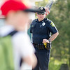 Officer Jason Tamulen keeps a watchful eye as students from Meetinghouse and Westminster Elementary School participate in the Walk to School Day in Friday morning. SENTINEL & ENTERPRISE / Ashley Green