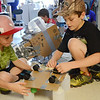 Max Carignan, 10, and Kyle Soule, 9, work to create a balloon powered car during Club Invention at Westminster Elementary School on Thursday afternoon. SENTINEL & ENTERPRISE / Ashley Green