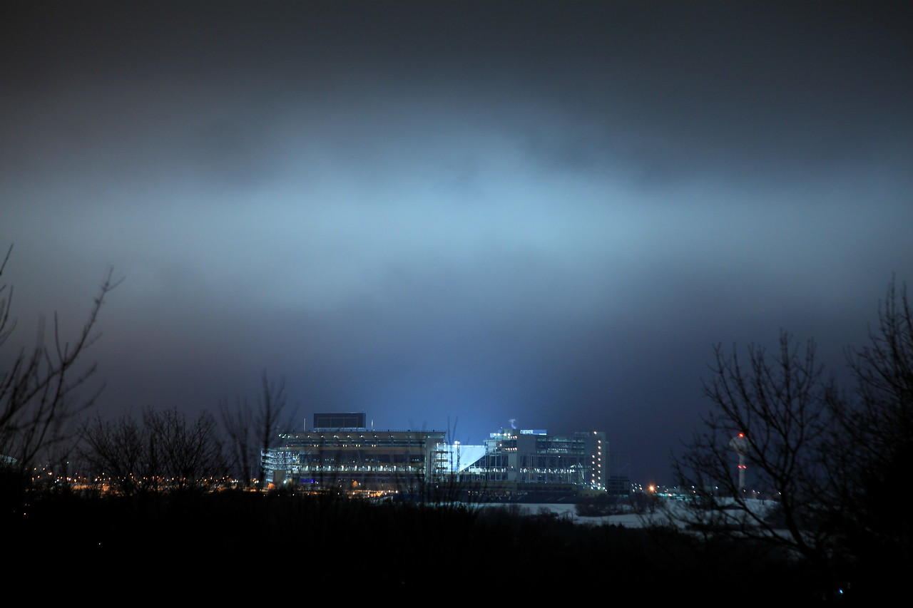 Beaver Stadium lit up and lighting up a stormy night sky on the night of Joe Paterno's death, January 22, 2012.