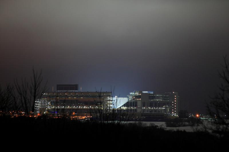 Beaver Stadium lit up and lighting up a stormy night sky on the night of Joe Paterno's death, January 22, 2012.
