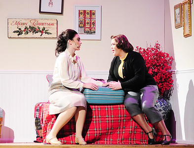 Sisters Judy Haynes, left played by Rianna Lyden and Betty Haynes played by Maria Cade discuss Betty's reasons for leaving the lodge in Vermont.