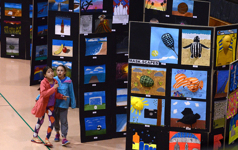 Bob Raines--Montgomery Media<br /> Two friends weave in and out of the displays of student art at the Wissahickon School District Art Show May 21, 2015.