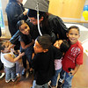 "Graduate Cassandra Medina is surrounded by her children, Arihanna, left, Alicia, Anthony, Aleah, and Angel, after the graduation ceremony.<br /> Workforce Boulder County held its Summer 2010 GED graduation on Friday at the Izaak Walton Clubhouse in Longmont.<br /> For more photos of the graduation, go to  <a href=""http://www.dailycamera.com"">http://www.dailycamera.com</a>.<br /> Cliff Grassmick / August 20, 2010"