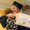 "Graduate, Becky Stirling, has a huge hug for Tonja Yelton of Workforce Boulder County.<br /> Workforce Boulder County held its Summer 2010 GED graduation on Friday at the Izaak Walton Clubhouse in Longmont.<br /> For more photos of the graduation, go to  <a href=""http://www.dailycamera.com"">http://www.dailycamera.com</a>.<br /> Cliff Grassmick / August 20, 2010<br /> <br /> Could LEDE"