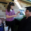 "Samantha Pinley makes some adjustments to her father, Bobbie's tassel, as sister, Rayanna, looks on after the ceremony.<br /> Workforce Boulder County held its Summer 2010 GED graduation on Friday at the Izaak Walton Clubhouse in Longmont.<br /> For more photos of the graduation, go to  <a href=""http://www.dailycamera.com"">http://www.dailycamera.com</a>.<br /> Cliff Grassmick / August 20, 2010"