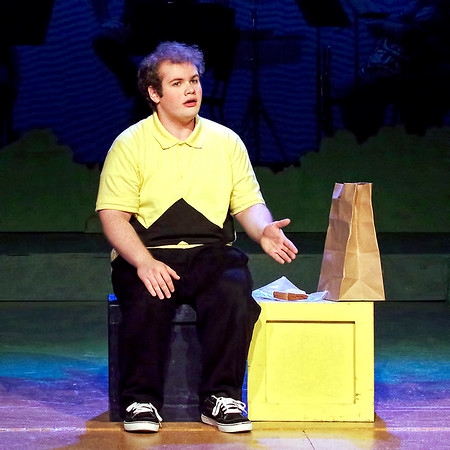 "Mark Maynard | for The Herald Bulletin<br /> Charlie Brown (Isaac Derkach) tries to get his courage up to approach the Little Red-Haired Girl in Anderson University's production of ""You're a Good Man, Charlie Brown."""