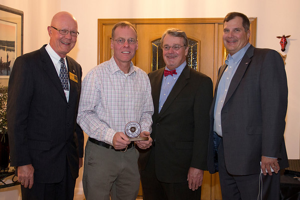 Mike Leite, Chadron State College professor of science, displays the 2011-2012 Teaching Excellence Award. He is accompanied by Gary Bieganski, Stan Carpenter and Randy Rhine, who presented the award Sept. 6. (Photo by Justin Haag