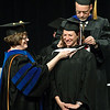 Rana Tucker of Chadron is hooded by her advisor, Dr. Mike Leite, and Dr. Margaret Crouse, dean, at the Chadron State College graduate commencement ceremony. The college conferred 71 graduate degrees Saturday, May 7. (Photo by Daniel Binkard/Chadron State College)