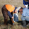 Brice Bultmann, junior, of Yutan, and Dr. Mike Leite, professor of geoscience, conduct stream cross section measurements on Chadron Creek. (Photo by Deann Stearns)