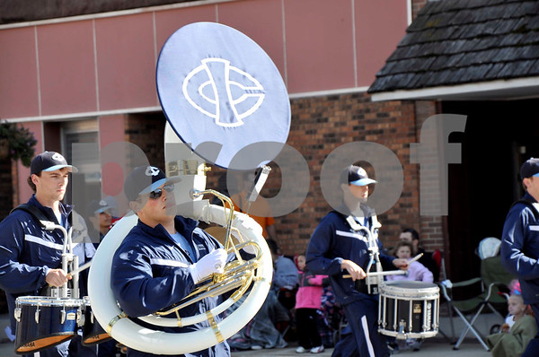 - Messenger photo by Peter Kaspari<br /> <br /> Trae Fistler, of the Iowa Central Community College marching band, holds onto his tuba as the band prepares to turn a corner during the Algona Band Days Festival parade. Fistler, who also participated in last year's parade, said he enjoyed being a part of the festival as well as watching other bands compete.