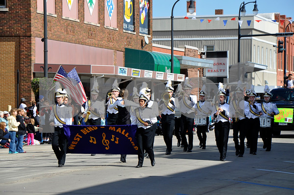 - Messenger photo by Peter Kaspari<br /> <br /> The West Bend-Mallard marching band shows off their talents during the annual Algona Band Days Festival parade Saturday.