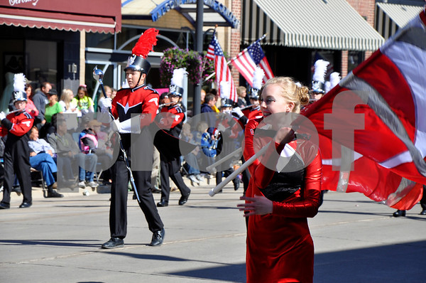 - Messenger photo by Peter Kaspari<br /> <br /> Brooke Boettcher happily spins the flag of the Algona Middle School marching band Saturday afternoon during the annual Band Days Festival. Boettcher said preparing for the festival is hard work, but once it happens everybody works together to put on their best performance.