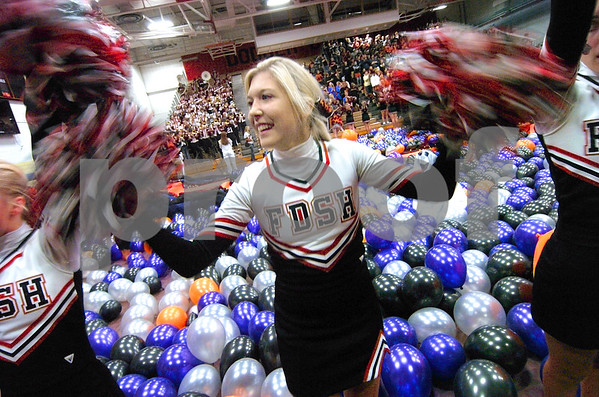 -Messenger photo by Hans Madsen<br /> <br /> Fort Dodge Senior High School cheerleader Kelsey Beck encourages the Dodgers to go onto victory Friday afternoon during a pep rally before the start of the annual homecoming coronation.