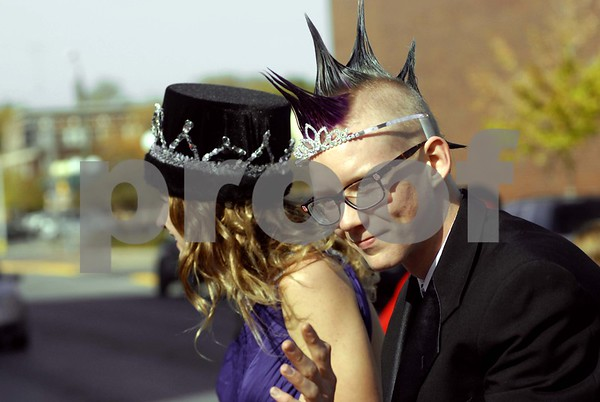 -Messenger photo by Hans Madsen<br /> <br /> Freshly crowned 2012 Fort Dodge Senior High School homecoming royalty Nicole Cook and Stefan Crowl wave at the crowd along Central Avenue during the annual homecoming parade. Due to Crowl's spiked hairdo, the pair switched headgear.