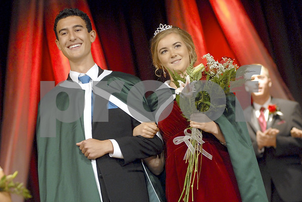 -Messenger photo by Hans Madsen<br /> <br /> Freshly crowned 2012 St. Edmond High School royalty Seth Reel, at left, and Mary Eide, beam at the audience Friday morning during the annual Homecoming Coronation.