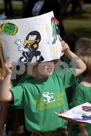 -Messenger photo by Hans Madsen<br /> <br /> Gracie Winkel, a kindergartner at St. Edmond Grade School, uses her Gaels spirit sign as an eye shade Friday afternoon while watching the spirit parade make it's way past the school.