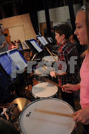 -Messenger photo by Joe Sutter<br /> <br /> Sixth graders Clayton Smith, of Paton-Churdan, and Sarah Phelps of St. Ansgar work on their snare drum part in the drum sectional as the rest of the band prepares to rehearse.