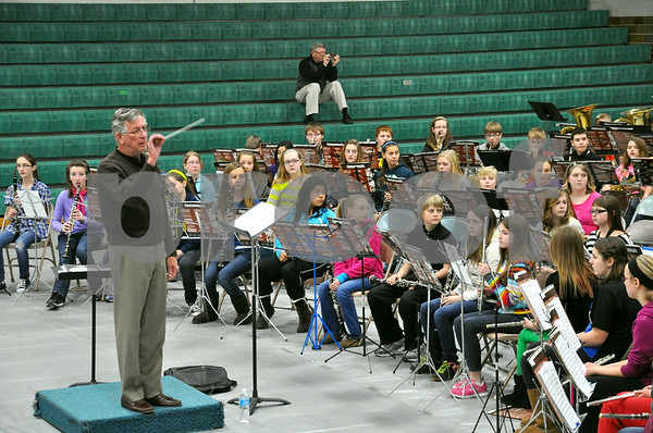 -Messenger photo by Joe Sutter<br /> <br /> Conductor Guy Blair leads the trumpet section in a difficult fanfare while the rest of the seventh grade band listens at the Karl King Honor Band festival at St. Edmond Middle school.