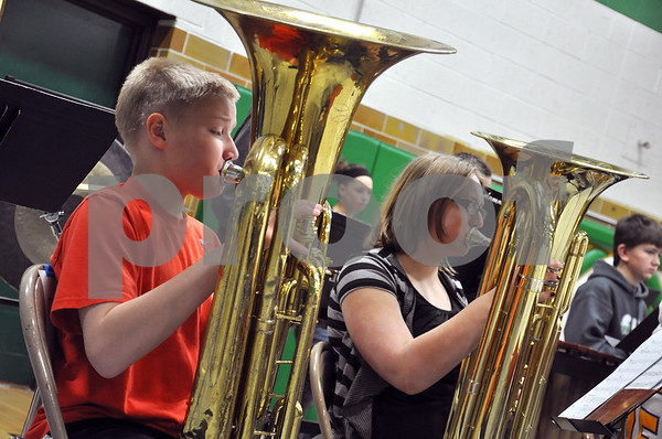 -Messenger photo by Joe Sutter<br /> <br /> Seventh graders Ben Jongewaard, left, and Cheyenne Palmer, both from Sheldon, said they had to leave at 5:30 a.m. to get to their first ever Karl King Honor Band festival.