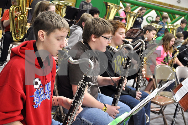 -Messenger photo by Joe Sutter<br /> <br /> Nick Martinson, Phillips Middle School (left), Austin Brower, Brit, and Jacob Bescke, Humboldt, provide lower tones with their bass Clarinets. Martinson said the complicated rhythms in the honor band pieces are fun to play.