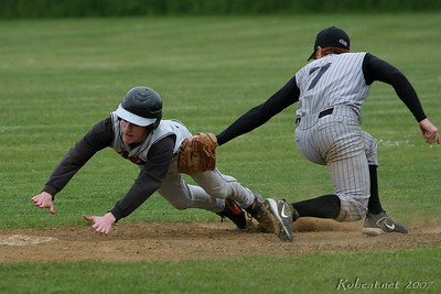 Brennan Keller (Napavine) couldn't quite avoid the tag by Zack Quimby (Ocosta) in attempt to steal 2nd base.