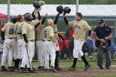 """Bryan Lininger celebrates with Adna teammates after hitting his third home run of the day. ------------------ Pirates are Overwhelming Adna Bats Stay Hot in Victory Over Napavine to Reach Final Four  by Kevin Westrick  ADNA - The Adna baseball team is just plain offensive ... literally.  The Pirates clubbed their way to the State Class 2B Region II Baseball Tournament title on their home field Saturday with another offensive display.  """"Their offense is just so tough to stop,"""" said Napavine coach Bryan Bullock, after the Pirates beat the Tigers 15-3 in the regional title game.  It was a cloudy afternoon in Adna. A consistent breeze kept the Pirate flag in right-centerfield in full display as a reminder to where everyone was.  Adna started its day with a 20-4 bashing of Quilcene while Napavine knocked out Seattle Lutheran 2-1 (see related story, page S3).  Adna now heads to the state semifinals in Yakima where the Pirates get a familiar foe - White Pass. The Panthers won the Region I title Saturday.  The Pirates banged out 35 hits in their two regional games, which matched their 35 runs.  How potent have the Pirates been of late? Lethal. Adna has scored 126 runs in its last eight games.  """"I really don't know where it came from,"""" said Adna coach Rex Ashmore. """"One-to-nine (batting order) are getting it done.""""  Bryan Lininger had a huge day with three homers overall to run his season total to 11.  """"I felt good today,"""" Lininger said. """"This has been great, but I never thought it would be this great.""""  It was Lininger's blast that broke open the Napavine game.  Adna had grabbed a 1-0 lead when Nick Pettit, the No. 9 hitter, delivered a two-out RBI single to score Peter Wagner in the second inning.  Napavine starter Connor Craft had kept the Pirates off balance in the first three innings. He had given up four hits, but all singles.  It all changed in the fourth.  Wagner started things with a short fly to left field that was dropped by Devil Carroll. Colby Fitzgerald quickly """